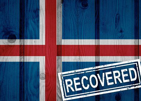 flag of Iceland that survived or recovered from the infections of corona virus epidemic or coronavirus. Grunge flag with stamp Recovered Stok Fotoğraf