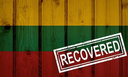 flag of Lithuania that survived or recovered from the infections of corona virus epidemic or coronavirus. Grunge flag with stamp Recovered Stok Fotoğraf