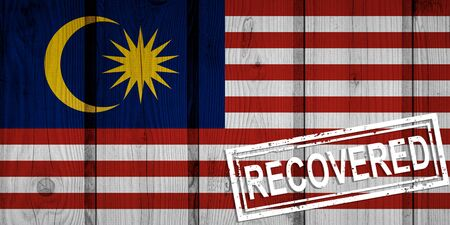 flag of Malaysia that survived or recovered from the infections of corona virus epidemic or coronavirus. Grunge flag with stamp Recovered Stok Fotoğraf