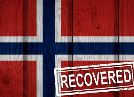 flag of Norway that survived or recovered from the infections of corona virus epidemic or coronavirus. Grunge flag with stamp Recovered Stok Fotoğraf