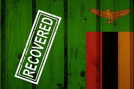 flag of Zambia that survived or recovered from the infections of corona virus epidemic or coronavirus. Grunge flag with stamp Recovered
