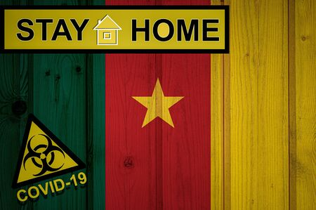 Flag of the Cameroon in original proportions. Quarantine and isolation - Stay at home. flag with biohazard symbol and inscription COVID-19.