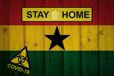Flag of the Ghana in original proportions. Quarantine and isolation - Stay at home. flag with biohazard symbol and inscription COVID-19.