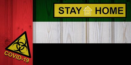 Flag of the United Arab Emiratesin original proportions. Quarantine and isolation - Stay at home. flag with biohazard symbol and inscription COVID-19. Stok Fotoğraf
