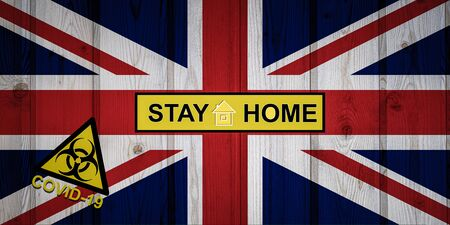 Flag of the United Kingdom in original proportions. Quarantine and isolation - Stay at home. flag with biohazard symbol and inscription COVID-19.