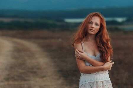 Positive natural close up portrait of young gorgeous caucasian ginger girl with freckles. Healthy lifestyle, beauty, natural concept. Melancholic beautiful portrait