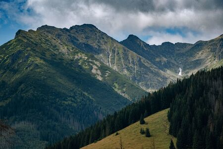 amazing nature, summer in the mountains. Travel and hike. Tatra Mountains in summer time. beautiful panorama of agricultural area. gorgeous mountain ridge with high rocky peaks