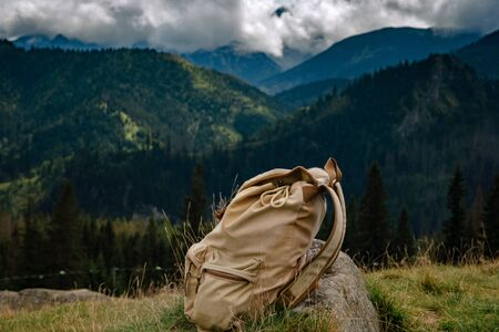 Backpack of free space for your decoration. Summer trip. Tatra National Park Poland Banque d'images
