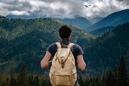 Man hiking at mountains with heavy backpack Travel Lifestyle wanderlust adventure concept summer vacations outdoor alone into the wild. Tatra National Park, Poland 版權商用圖片