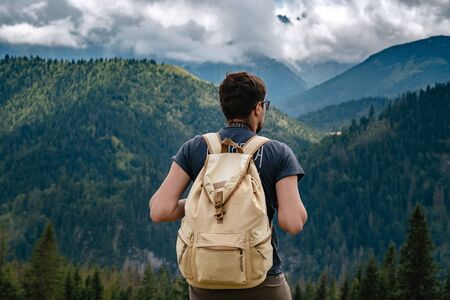 Man hiking at mountains with heavy backpack Travel Lifestyle wanderlust adventure concept summer vacations outdoor alone into the wild. Tatra National Park, Poland Banque d'images