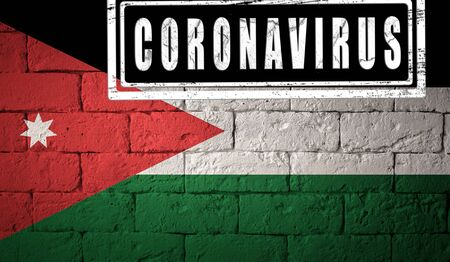 Flag of the Jordan with original proportions. stamped of Coronavirus. brick wall texture. Corona virus concept. On the verge of a COVID-19 or 2019-nCoV Pandemic. Stock Photo
