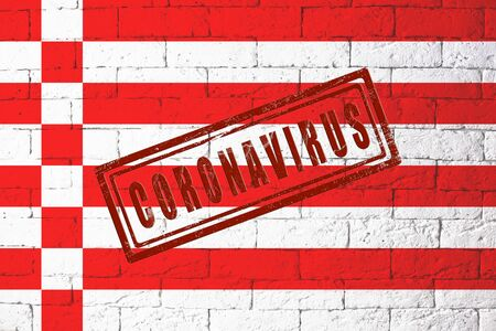 Flag of the regions of Germany Bremen with original proportions. stamped of Coronavirus. brick wall texture. Corona virus concept. On the verge of a COVID-19 or 2019-nCoV Pandemic. Stock Photo