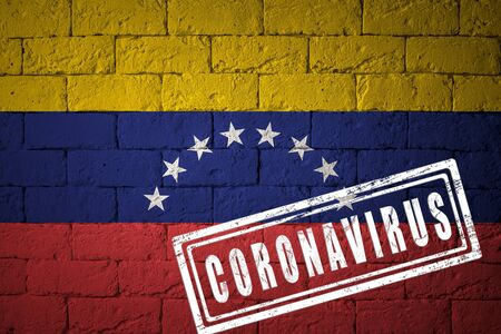 Flag of the Venezuela with original proportions. stamped of Coronavirus. brick wall texture. Corona virus concept. On the verge of a COVID-19 or 2019-nCoV Pandemic.