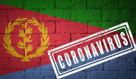 Flag of the Eritrea on brick wall texture. stamped of Coronavirus. Corona virus concept. On the verge of a COVID-19 or 2019-nCoV Pandemic. Novel Coronavirus outbreak Stock Photo