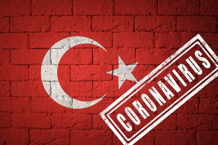 Flag of the Turkey with original proportions. stamped of Coronavirus. brick wall texture. Corona virus concept. On the verge of a COVID-19 or 2019-nCoV Pandemic. Stock Photo