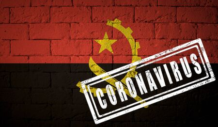 Flag of the Angola on brick wall texture. stamped of Coronavirus. Corona virus concept. On the verge of a COVID-19 or 2019-nCoV Pandemic. Stock Photo