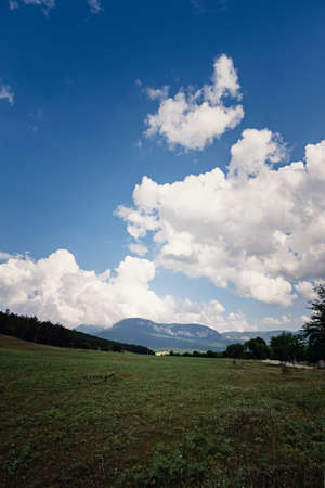 Summer green rural nature landscape. beautiful sky with clouds in the sunny and green hills.