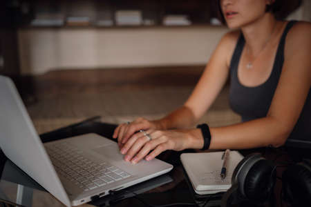 Young asian female student using laptop, communicates on internet. Cozy office workplace, remote work, E learning concept. closeup hands Zdjęcie Seryjne
