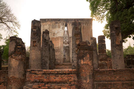 Seated Buddha image at Wat Si Chum temple in Sukhothai Historical Park, a heritage site in Thailand