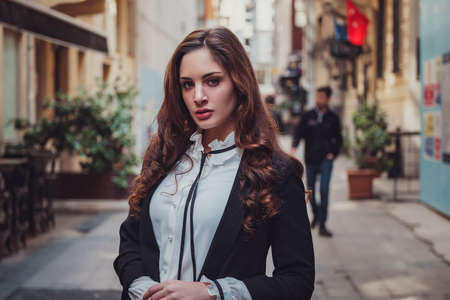 Beautiful stylish young latin woman walking the atmospheric streets of Istanbul, Turkey. The idea and concept of an interesting vacation, adventure in an amazing city