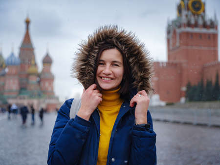 Asian tourist in travel vacations in winter Moscow. woman posing in cold Red Square in central Moscow, 免版税图像
