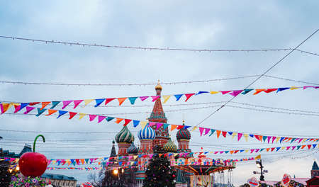 Celebration of the New Year and Christmas on the Red Square in the center of Moscow. Holiday fair and amusement park near the Kremlin.