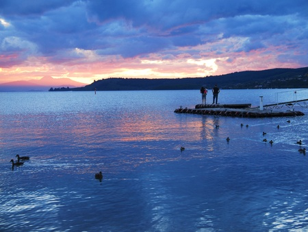 Sunset of Taupo lake photo