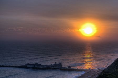 Sunset overlooking a Pier in Lima  Stock Photo - 3116975