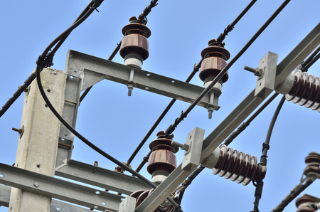 semi conductor: PORCELAIN INSULATOR - POST TYPE INSULATORS IN NATURE DAY LIGHT (SELECTIVE FOCUS)