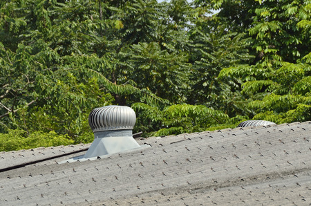 ROOF VENTILATOR - SELECTIVE FOCUS TO THE ROOF VENTILATOR IN NATURE DAY LIGHT OF FACTORY. Stock Photo