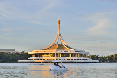 ix: Ratchamangkhala Pavilion of Suan Luang Rama IX Public Park Bangkok,Thailand in twilight time. Back side view of the Pavilion is a fresh water lake. This Place is opened public for exercise or relax. Stock Photo