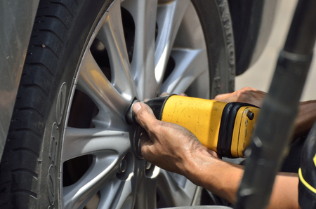 alloy: Change the tires or wheel with auto screw in automobile repair shops (Selective focus).