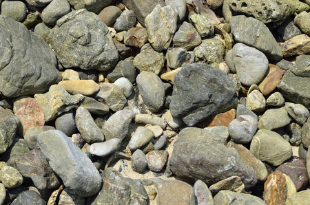 ange: Stone on the beach in midday (Selective focus) Stock Photo