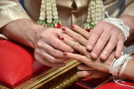 Traditional Thai Wedding Ceremony. Groom Put the Wedding Ring on bride (Select focus).