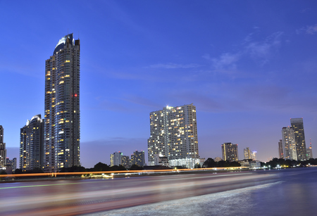 Bangkok city in the night (Select focus). The location nearby the Chaophraya river. Stock Photo