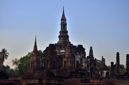Old temple at sunrise time in Sukhothai historical park of thailand.