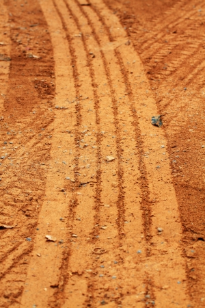 Abstract background - the wheel tracks in the sand   Stock Photo