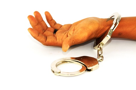 Criminal hands locked in handcuffs  Stock Photo - 14244164