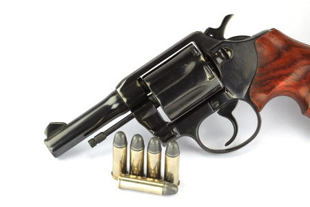 Old revolver with bullets on white background Stock Photo - 14293868