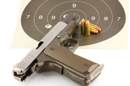 9-mm handgun and target shooting Stock Photo - 14533470