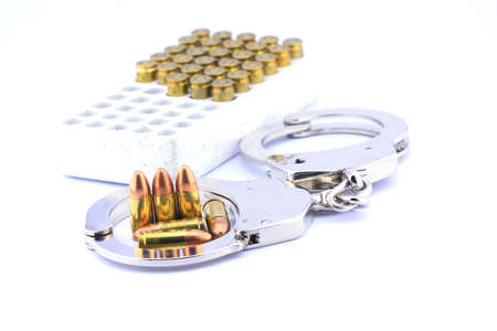 restraints: Close up Bullets 9 mm and  police handcuff
