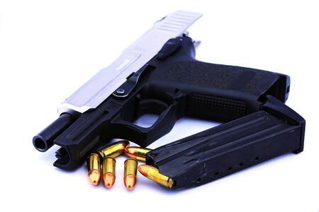 Handgun and bullets on white background Stock Photo - 14732856