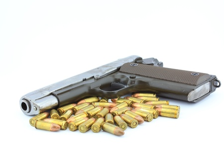 Handgun and bullets  on white background Stock Photo - 14732889