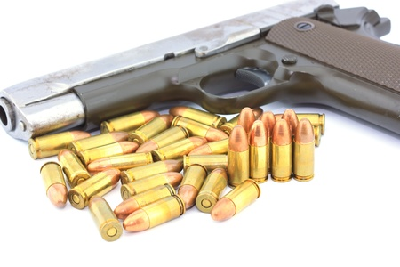 Handgun and bullets  on white background Stock Photo - 14732893
