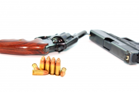 ceasefire: Semi-automatic Pistol and Revolver with bullets on white background