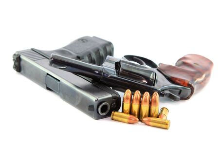 ceasefire: Semi-automatic Pistol with Bullets and revolver  on white background Stock Photo