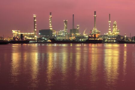 Oil refinery factory at riverside in twilight ,Thailand