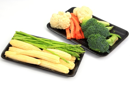 Fresh Baby corn and Asparagus with set vegetables on white background