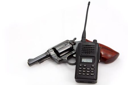 Handgun revolver and Police Radio communication on white background Stock Photo - 16946224