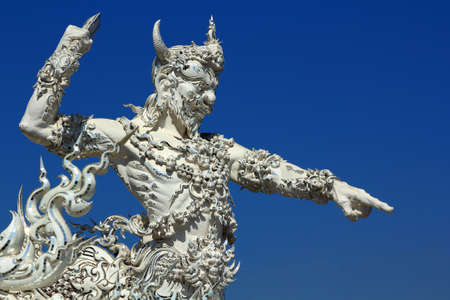 Statue in Temple White at Chiang Rai, Thailand
